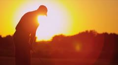 Golfer Driving Off Sunset Golf Resort Fairway Stock Footage