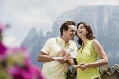 Italy, South Tyrol, Couple holding coffee cups, outdoors Stock Photos