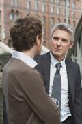 Germany, Hamburg, Two businessmen talking - stock photo