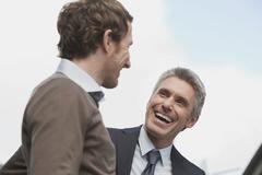 Stock Photo of Germany, Hamburg, Two businessmen talking