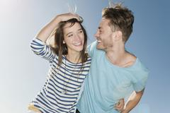 Germany, Berlin, Young couple laughing, portrait Stock Photos