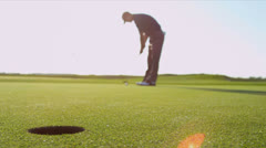 Golf Ball Going Wide Hole Golfer Watching - stock footage
