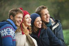 Germany, Bavaria, English Garden, Four persons laughing, portrait, close-up - stock photo