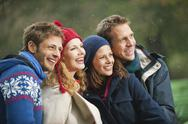 Stock Photo of Germany, Bavaria, English Garden, Four persons laughing, portrait, close-up