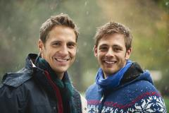 Germany, Bavaria, English Garden, Two men standing side by side, smiling, - stock photo