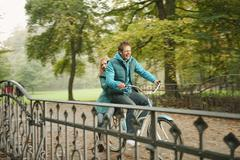 Germany, Bavaria, Munich, English Garden, Couple riding bicycle - stock photo