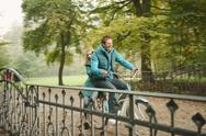 Stock Photo of Germany, Bavaria, Munich, English Garden, Couple riding bicycle