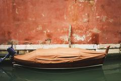 Italy, Venice, Boat anchoring in canal - stock photo