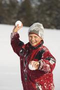 Austria, Steiermark, Boy (12-13) holding snowball, smiling, portrait - stock photo