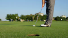 Male Professional Golfer Holing the Shot Stock Footage