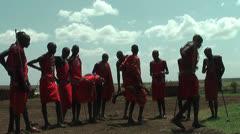 Masai Warrior dancing and singing in Manyatta in Kenya Stock Footage