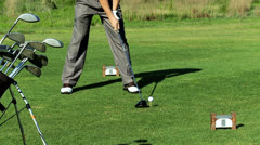 Close Up Golf Ball Tee Golfer Practice Swing - stock footage