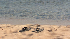Stock Video Footage of SANDALS ON THE SAND