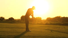 Professional Golfer Sunset Teeing Off Stock Footage