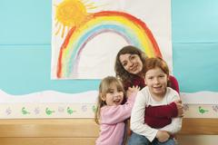 Germany, Female Nursery-school teacher and girls  (4-5), (5-6) in nursery, Stock Photos
