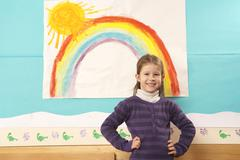 Stock Photo of Germany, Portrait of a girl (4-5) in nursery, hands on hip