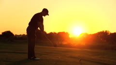 Golfer Driving Off Sunset Golf Resort Fairway Stock Footage