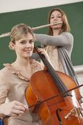 Germany, Emmering, Teenage girl and young woman playing musical instruments - stock photo