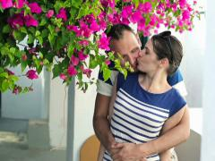 Stock Video Footage of Couple in love kissing under tree with bloom flowers NTSC