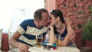 Couple in love kissing in cafe HD Stock Footage