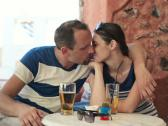 Couple in love kissing in cafe NTSC Stock Footage