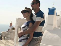 Tourist couple in love on romantic trip to Santorini NTSC Stock Footage