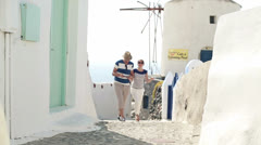 Tourist couple with tablet computer sightseeing Santorini HD - stock footage