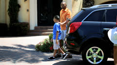 Young African American Family Unpacking Car After Outing - stock footage