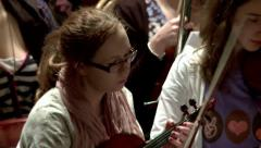 Girls practicing before a live orchestral performance - stock footage