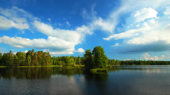 Summer nature, forest lake landscape with sky and clouds, time-lapse. Stock Footage