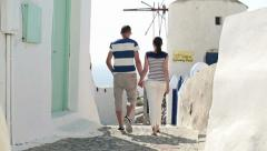 Tourist couple sightseeing Santorini HD Stock Footage
