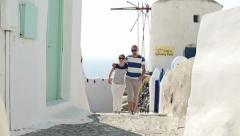 Tourist couple sightseeing Santorini HD - stock footage
