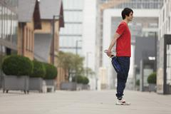 Stock Photo of Germany, Cologne, Young man doing exercise