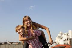 Stock Photo of Germany, Bavaria, Munich, Young couple enjoying on rooftop