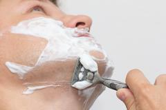 man shaves - stock photo