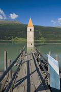 Italy, South Tyrol, Lake Reschensee with steeple - stock photo
