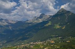 Italy, South Tyrol, Meran, Elevated view of city with mountains in background - stock photo