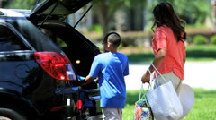 Young Ethnic Family Packing Car Beach Day - stock footage