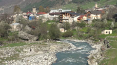 River flows through Mestia, Georgia Stock Footage