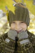 Germany, Munich, Boy (10-11) in warm clothing smiling, close-up - stock photo