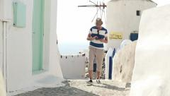 Tourist sightseeing Santorini with tablet computer HD - stock footage