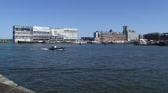 AMSTERDAM  Police patrol boat in Oude Houthaven + Silodam Stock Footage