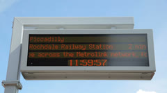 Notice board showing when metrolink tram is due, manchester, england Stock Footage