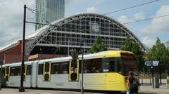 Manchester metrolink tram passes g-mex centre Stock Footage