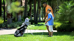 African American Father Son Practice Golf Swing Stock Footage