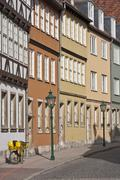 Germany, Hannover, Kreuz Street, Row of houses in city - stock photo