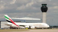Emirates a380 airbus taxiing past control tower after landing Stock Footage