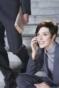 Germany, Bavaria, Munich, Business woman in underground station sitting on steps Stock Photos