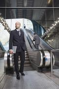 Germany, Bavaria, Munich, Business people at subway station, escalator in - stock photo