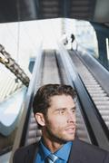 Germany, Bavaria, Munich, Business man at subway station, escalator in Stock Photos